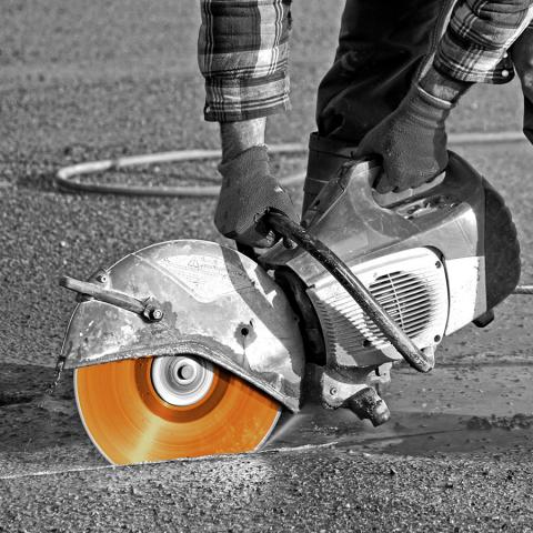 Disc Cutter Into Asphalt Road